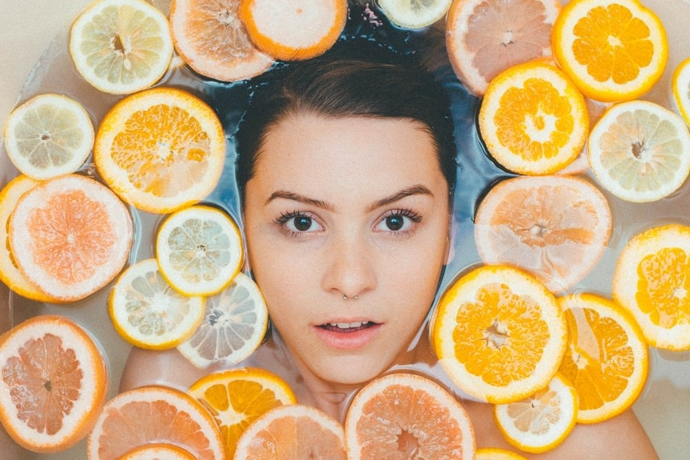 Girl with Citric Fruits